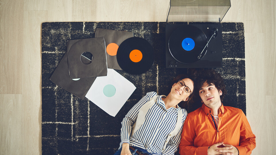 people on the floor - record player